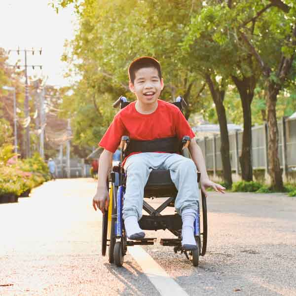 Child in wheelchair.
